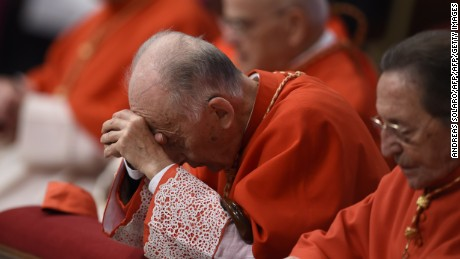 Cardinal Camillo Ruini prays during a papal mass for the 14th Ordinary General Assembly of the Synod of Bishops at St Peter's basilica on October 25, 2015 at the Vatican.  AFP PHOTO / ANDREAS SOLARO        (Photo credit should read ANDREAS SOLARO/AFP/Getty Images)
