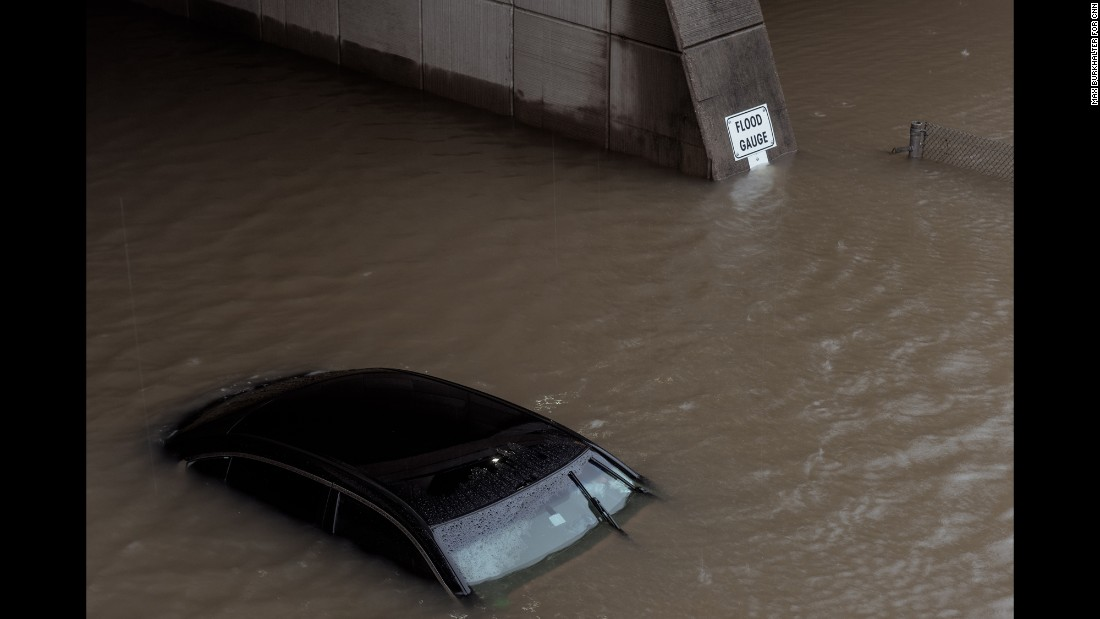 A car is submerged in floodwaters near an overpass 2 miles from Burkhalter's house.