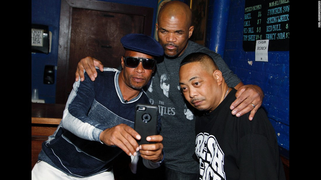 "Brother Marquis, left, and Fresh Kid Ice, right, of 2 Live Crew pose for a selfie with Darryl ""DMC"" McDaniels of Run DMC backstage at Rock The Vote's #TBT 25th Anniversary Concert in Washington on Thursday, October 22."