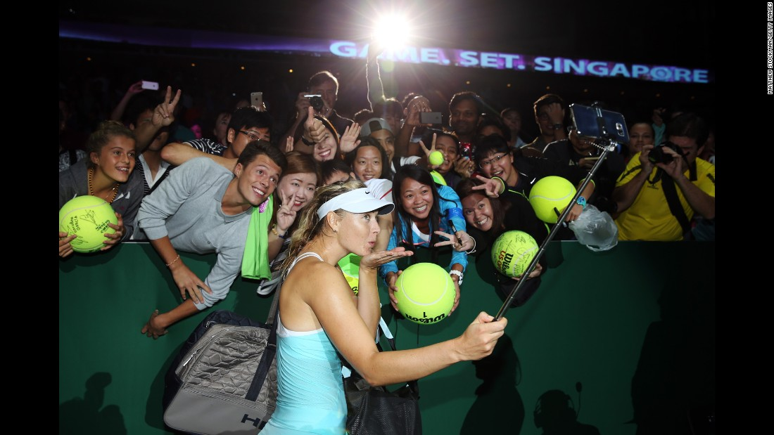 Maria Sharapova of Russia poses for a selfie after a three-set victory againt Poland's Agnieszka Radwanska in a round-robin match during the BNP Paribas WTA Finals in Singapore on Sunday, October 25.