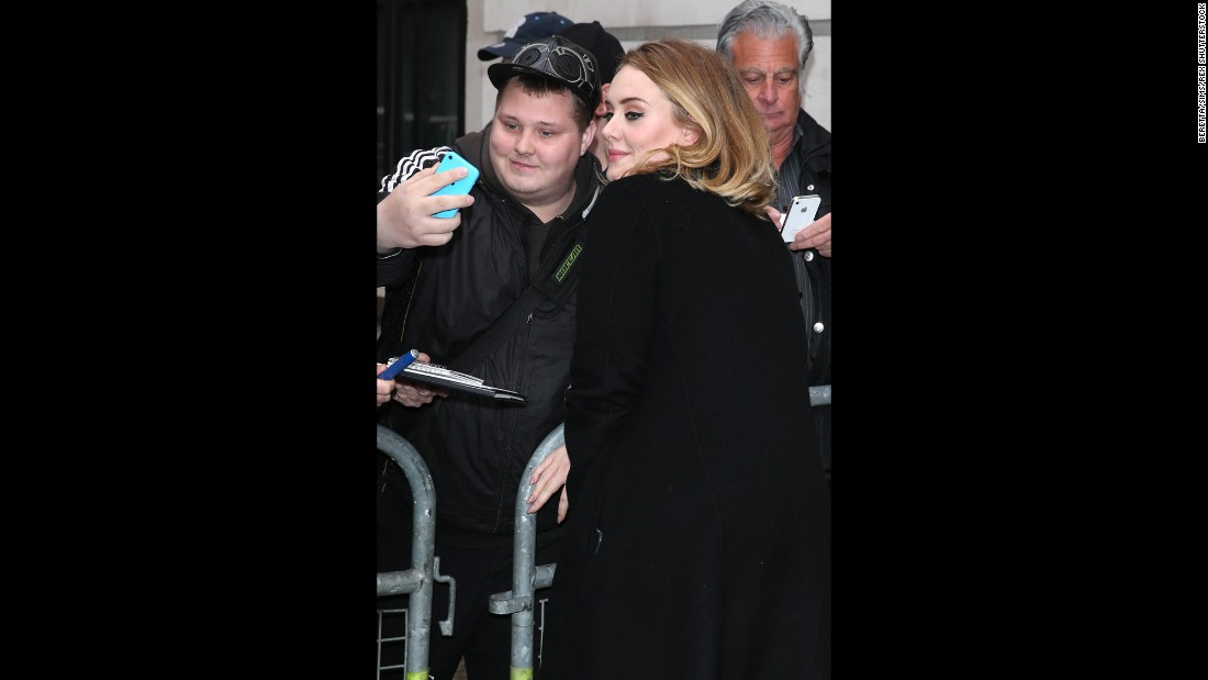 "Adele takes a selfie with a fan in London on Friday, October 23, the same day the song ""Hello"" from her upcoming album was released."