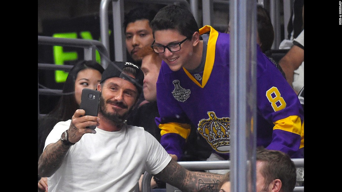 David Beckham and a fan take a selfie while attending a NHL game in Los Angeles on Friday, October 23. The Los Angeles Kings beat the Carolina Hurricanes 3-0.