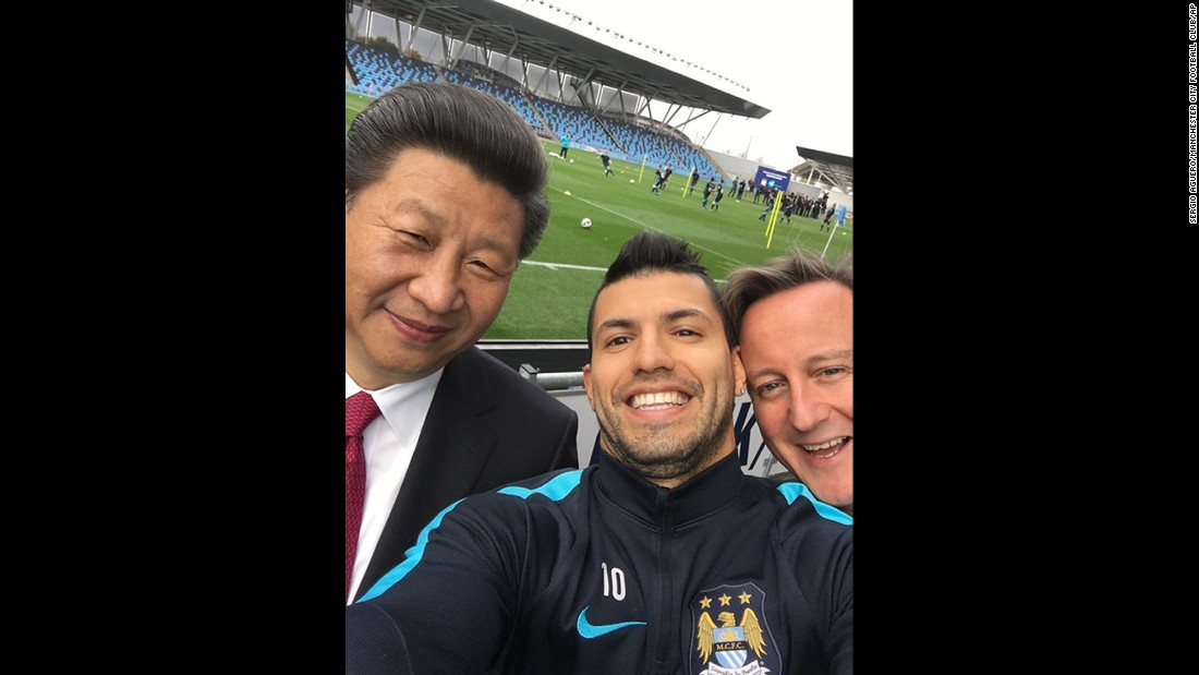 Soccer player Sergio Aguero takes a selfie with Britain's Prime Minister David Cameron, right, and Chinese President Xi Jinping in Manchester, England, on Friday, October 23.