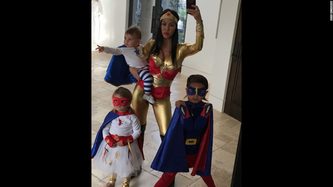 Kourtney Kardashian posted this family selfie to Instagram on Saturday, October 24. She was dressed as Wonder Woman in a red and gold jumpsuit.