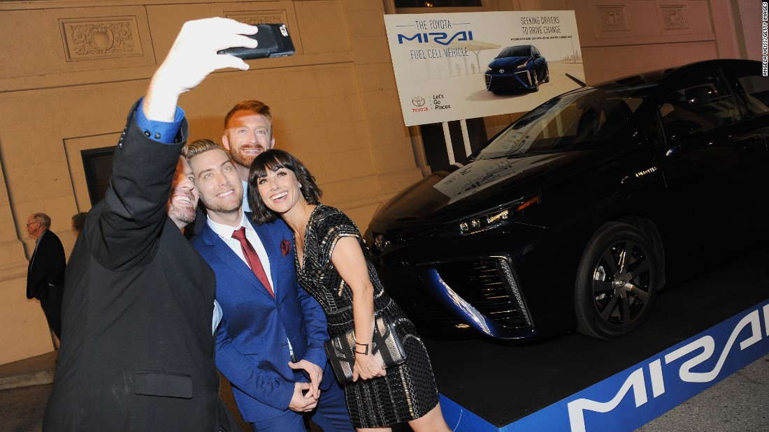 Host Lance Bass, center, and actress Constance Zimmer, right, pose for a selfie at the 25th annual Environmental Media Association Awards in Burbank, California, on Saturday, October 24.