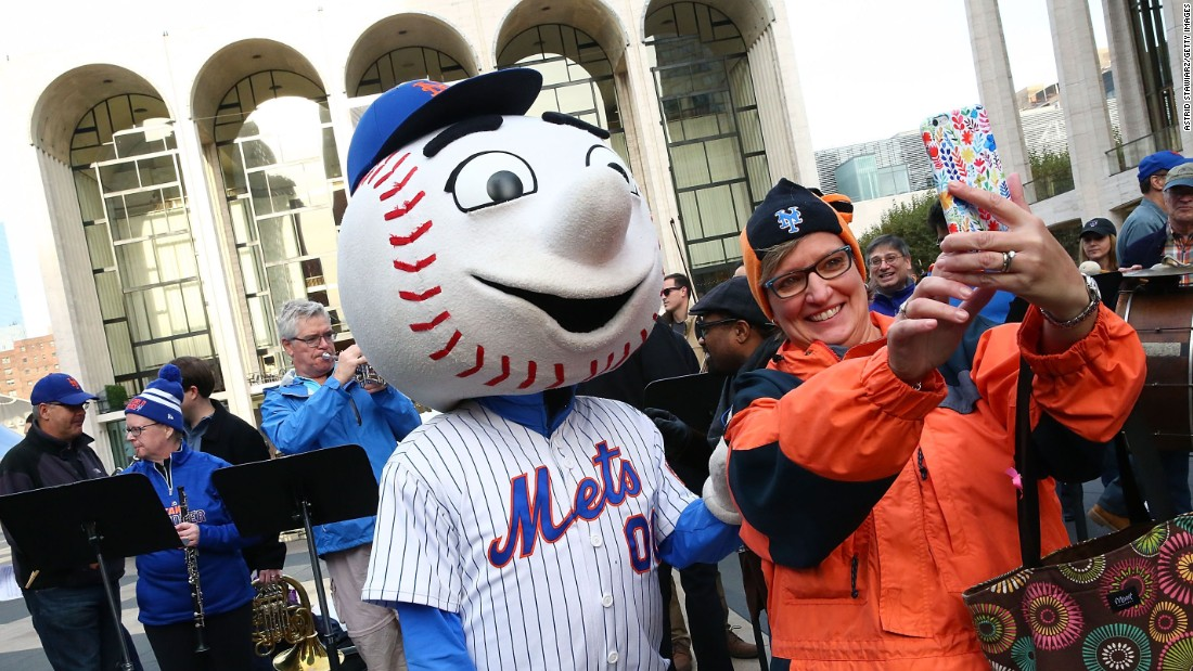"A New York Mets fan takes a selfie with Mr. Met during the Met Opera And Mr. Met performance of ""Meet the Mets"" in New York on Tuesday, October 27."