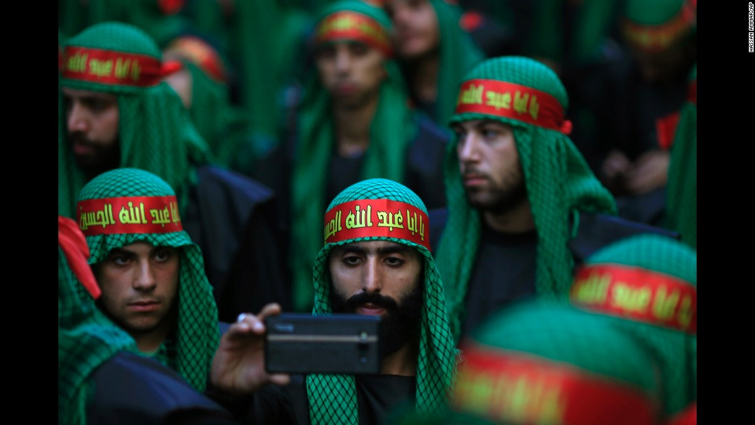 A Lebanese Shiite supporter of Hezbollah takes a selfie during the holy day of Ashura in southern Beirut, Lebanon, on Saturday, October 24.