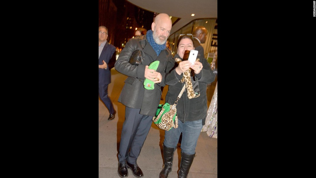 "R.E.M. singer Michael Stipe poses for  selfie with a fan outside the ""Miss You Already"" screening at the Museum of Modern Art in New York on Sunday, October 25."