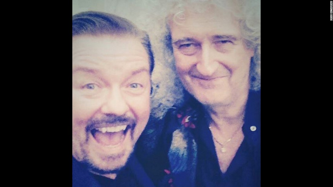 "Comedian Ricky Gervais shared this selfie with Queen guitarist Brian May from the 2015 Animal Hero Awards on Wednesday, October 21. Gervais said it was an ""absolute thrill to be presented with my animal hero award by the mighty Brian May."""