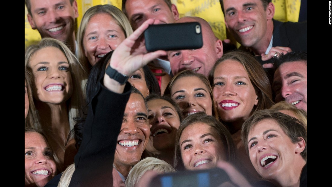 President Barack Obama poses for a selfie with members of the U.S. Women's National Soccer Team during an event honoring the world champion team at the White House on Tuesday, October 27.