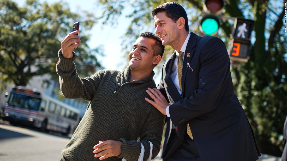 Rep. Paul Ryan, R-Wisconsin, poses for a selfie after a vote in the Capitol on Wednesday, October 21.