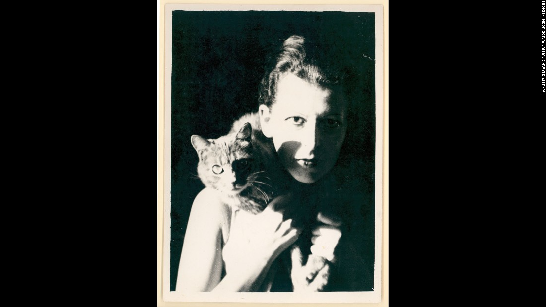 "Androgynous photographer Claude Cahun played with gender roles, championed surrealism, fought against the Nazis -- and was quite fond of cats. (One <a href=""http://www.thedailybeast.com/articles/2015/04/21/claude-cahun-the-lesbian-surrealist-who-defied-the-nazis.html"" target=""_blank"">neighbor remembers</a> her walking a leashed cat on a beach.) She even called a late-'40s series of photographs, ""The Way of Cats."""