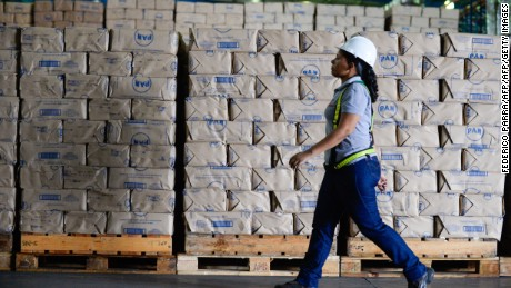 "A worker walks next to packages of corn flour at a distribution center of food company ""Empresas Polar"" in Maracay, Venezuela on October 27, 2015. Venezuelan businessman Lorenzo Mendoza discarded Tuesday to abandon the country after he was reported by the Chavism before the prosecutor's office for ""betraying his country"", which could take him to prison for several years. AFP PHOTO / FEDERICO PARRA        (Photo credit should read FEDERICO PARRA/AFP/Getty Images)"