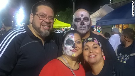 Valerie Vela, her husband and friends participated in their local festival by painting their faces