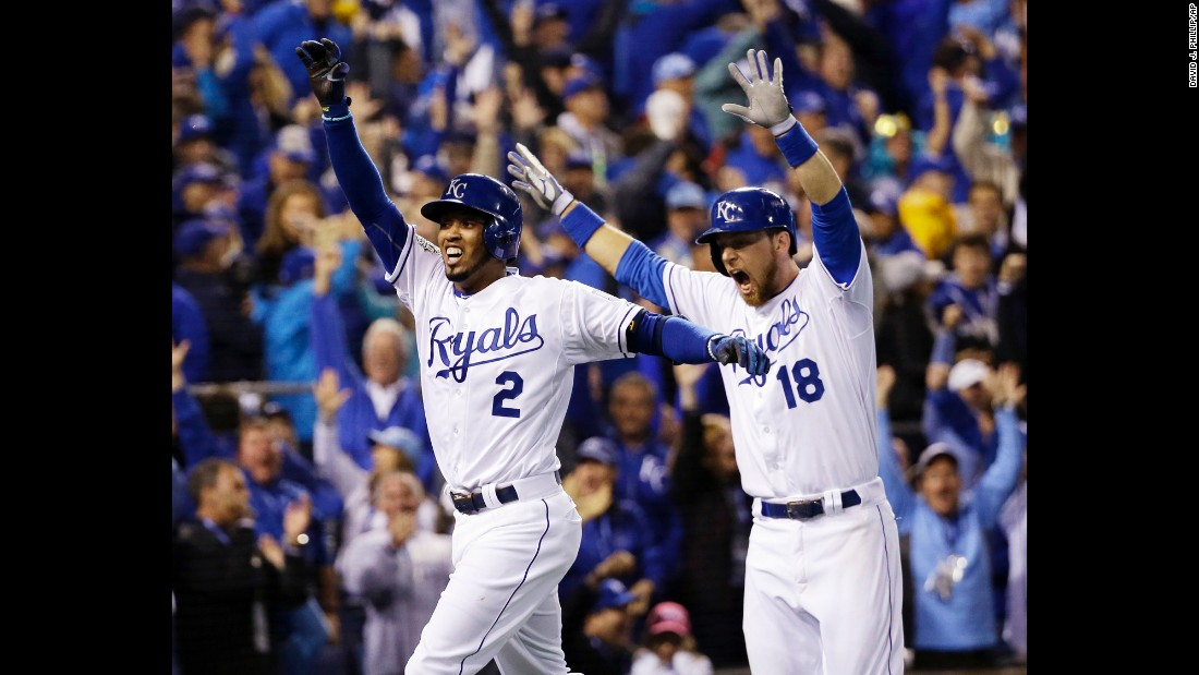 Royals shortshop Alcides Escobar, left, celebrates with teammate Ben Zobrist after hitting an inside-the-park home run on the first pitch of the game.