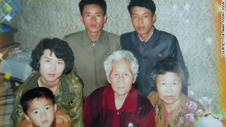 Ahn Yoon-Sook, center, and her sons and family members.