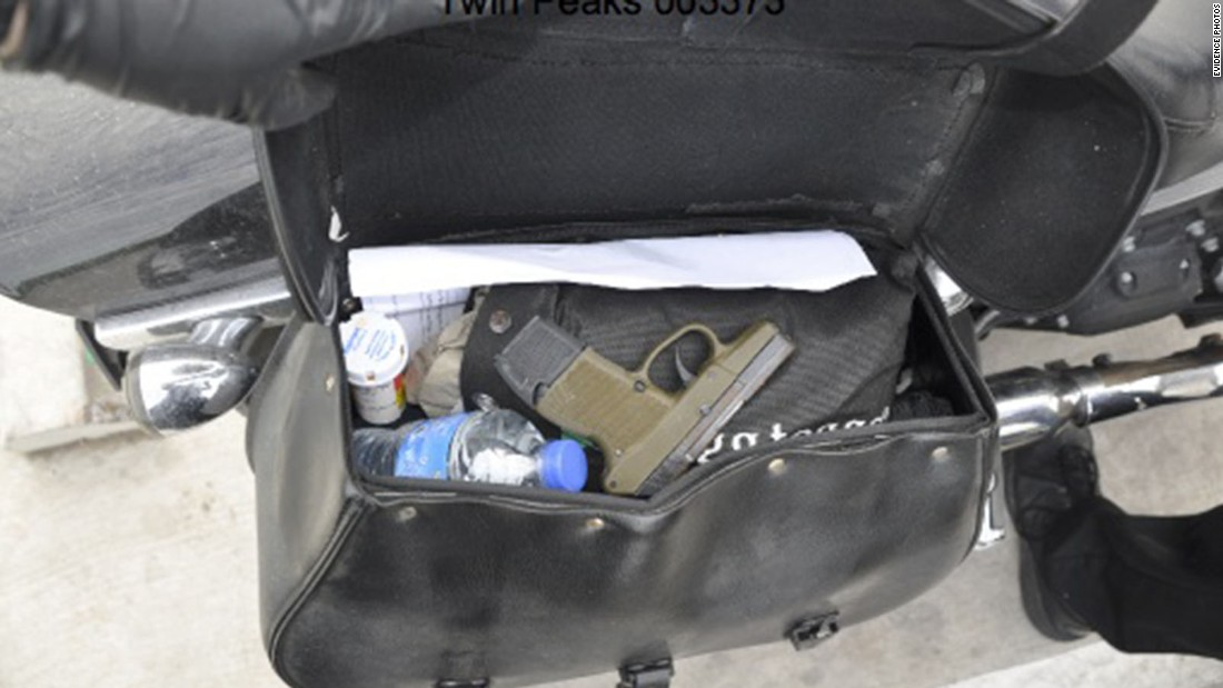 A gun is inside a motorcycle saddlebag, along with prescription medicine and a water bottle.