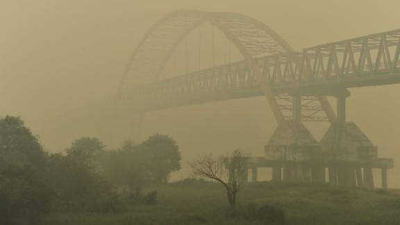 Kahayan Bridge is pictured through yellow, acrid haze in Palangkaraya on October 27, 2015.