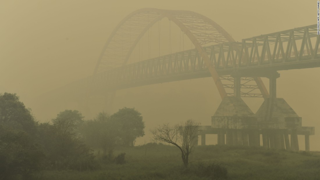 Kahayan Bridge is pictured through yellow, acrid haze in Palangkaraya on October 27, 2015.