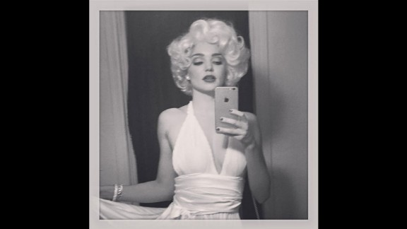 Australian model Miranda Kerr, dressed as Marilyn Monroe, shared this selfie on Sunday, October 25.