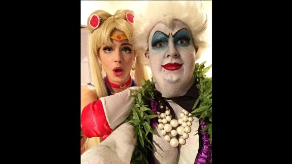 "Actor Colton Haynes and actress Emily Bett Rickards reveal their Halloween costumes in a selfie shared on Instagram on Sunday, October 25. Haynes was Ursula from ""The Little Mermaid,"" and Rickards was Sailor Moon."