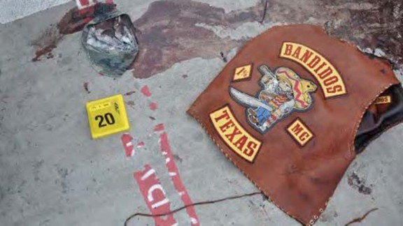 A Bandidos vest and hat are left behind in a pool of blood. The Bandidos boast a membership of 2,000 to 2,500 across not just the United States, but also 13 other countries, the Department of Justice says.
