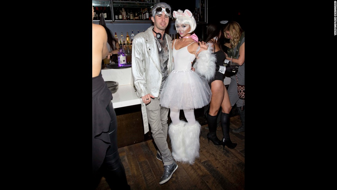 """Modern Family"" actress Sarah Hyland dressed as a snow-white kitty for Matthew Morrison's Halloween Masquerade Ball."