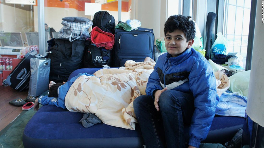 One of Hassan Abdo Ahmed Mohammed's children sits on the air mattress inside the Moscow airport terminal.