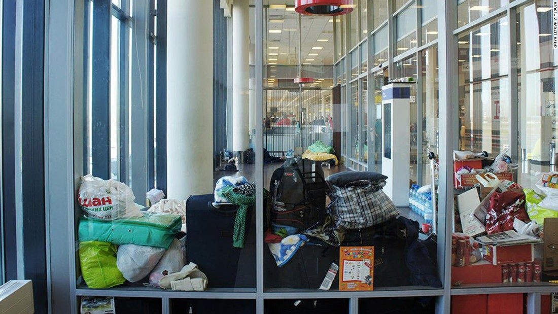 The family's possessions crowd a corner of the terminal.