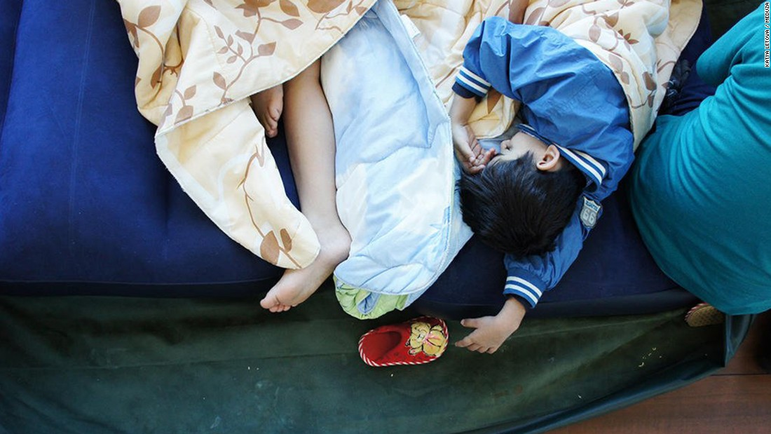 The children of Hassan Abdo Ahmed Mohammed sleep on an air mattress at a terminal in Moscow's Sheremetyevo International Airport.