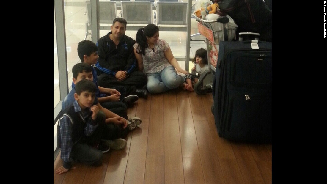Hassan Abdo Ahmed Mohammed, his wife and their four children wait in a Moscow airport terminal. They've been there about 50 days.