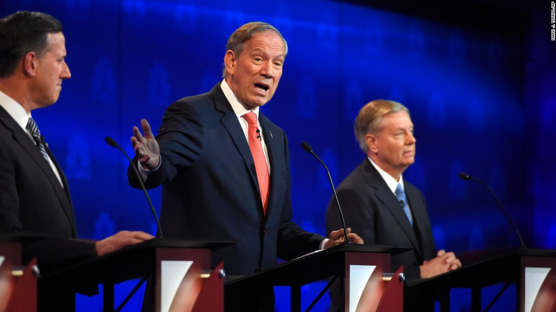 "Former New York Gov. George Pataki, center, also went after the Democrats. He said Hillary Clinton's private email server as secretary of state ""disqualifies"" her from being president."