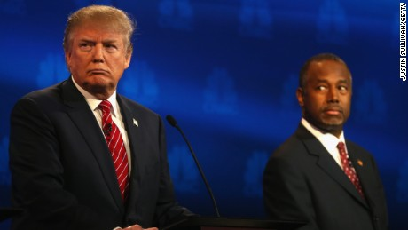 Donald Trump and Ben Carson look on during the CNBC Republican Presidential Debate on October 28, 2015, in Boulder, Colorado.