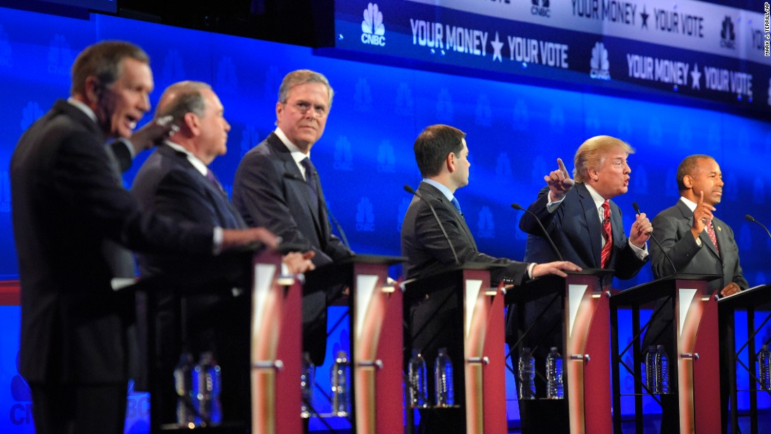 John Kasich, left, and Donald Trump argue across fellow candidates during the GOP debate at the University of Colorado in Boulder on Wednesday, October 28. Fourteen candidates participated in the third set of Republican presidential debates.