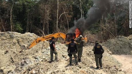 IBAMA agents set fire to a suspected illegal mining camp in Brazil's northern Para state.