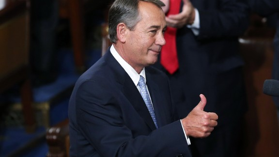 Outgoing Speaker of the House John Boehner (R-OH) gives a thumbs up to fellow members of the U.S. House of Representatives on the floor of the House chamber October 29, 2015 in Washington, DC.