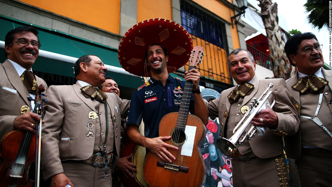 What can we expect from the return of the Mexican Grand Prix to the Formula One calendar after 23 years? Passionate fans are expected to be top of the Mexican menu. Here  Daniel Ricciardo of Australia and Infiniti Red Bull Racing poses with a mariachi band.
