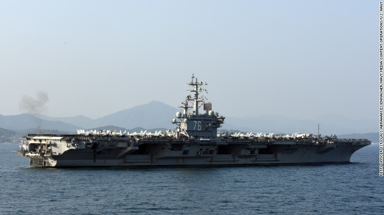 U.S. aircraft carrier stalked by submarine