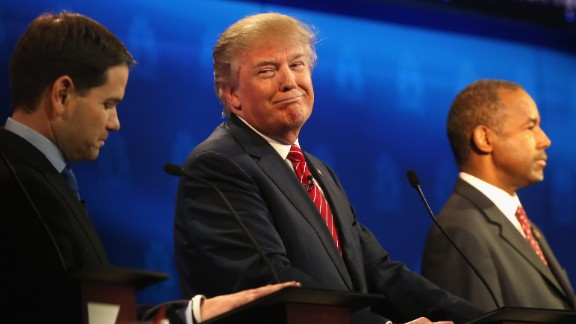BOULDER, CO - OCTOBER 28:  Presidential candidate Donald Trump (C) smiles while Sen. Marco Rubio (L)   and Ben Carson look on during the CNBC Republican Presidential Debate at University of Colorados Coors Events Center October 28, 2015 in Boulder, Colorado.  Fourteen Republican presidential candidates are participating in the third set of Republican presidential debates.  (Photo by Justin Sullivan/Getty Images)