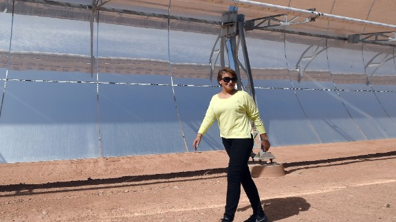 Morocco's environment minister Hakima El Haite walks in front of a solar array in 2015 that is part of the Noor 1 solar power plant, which opened in February 2016.