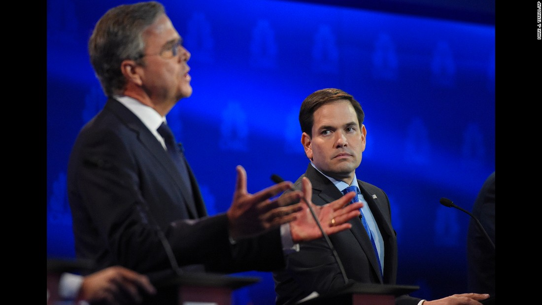 "Marco Rubio, right, watches as Jeb Bush speaks during the <a href=""http://www.cnn.com/2015/10/28/politics/gallery/republican-debates-colorado/"" target=""_blank"">Republican presidential debate</a> at the University of Colorado in Boulder on Wednesday, October 28. Bush went after Rubio for missing votes in the Senate while running for the White House. ""Just resign and let someone else take the job,"" Bush said. Rubio fired back, saying Bush never took issue with Sen. John McCain missing votes when he was running for president. ""The only reason you're doing it now is because we're running for the same position."" After the debate, Rubio gained in the polls while Bush dropped."