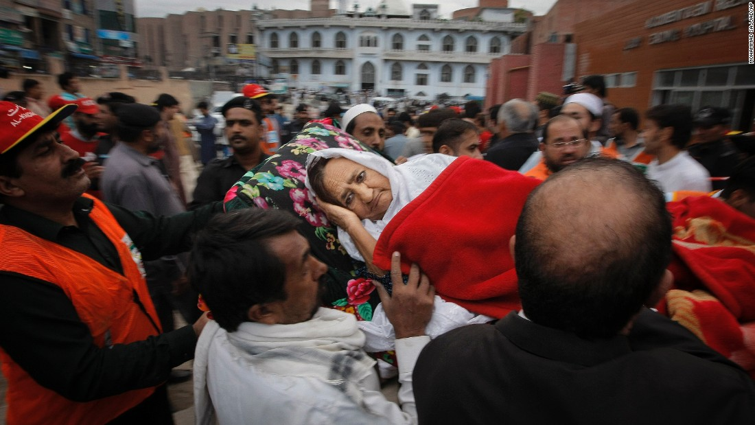 "People rush an injured woman to a local hospital in Peshawar, Pakistan, on Monday, October 26. A powerful 7.5-magnitude <a href=""http://www.cnn.com/2015/10/27/asia/afghanistan-pakistan-earthquake/"" target=""_blank"">earthquake in northern Afghanistan</a> rocked cities across South Asia."
