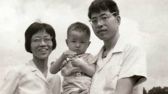 CNN's Steven Jiang aged about 2 with his mom and dad,  Jane Zhang and Zhaorong Jiang.