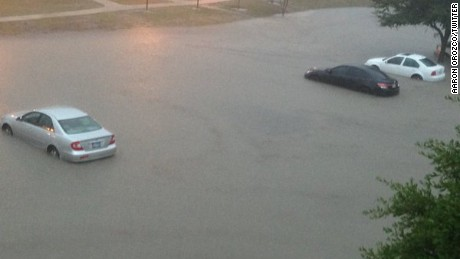 "Aaron Orozco saw this startling view from outside his apartment off I-35 in San Marcos, Texas. ""I was just in awe that the water was coming so fast,"" he said. Orozco moved his car at 8:20 a.m., which is when he snapped this image. https://twitter.com/Big_Ohhhhh/status/660090869815472128"