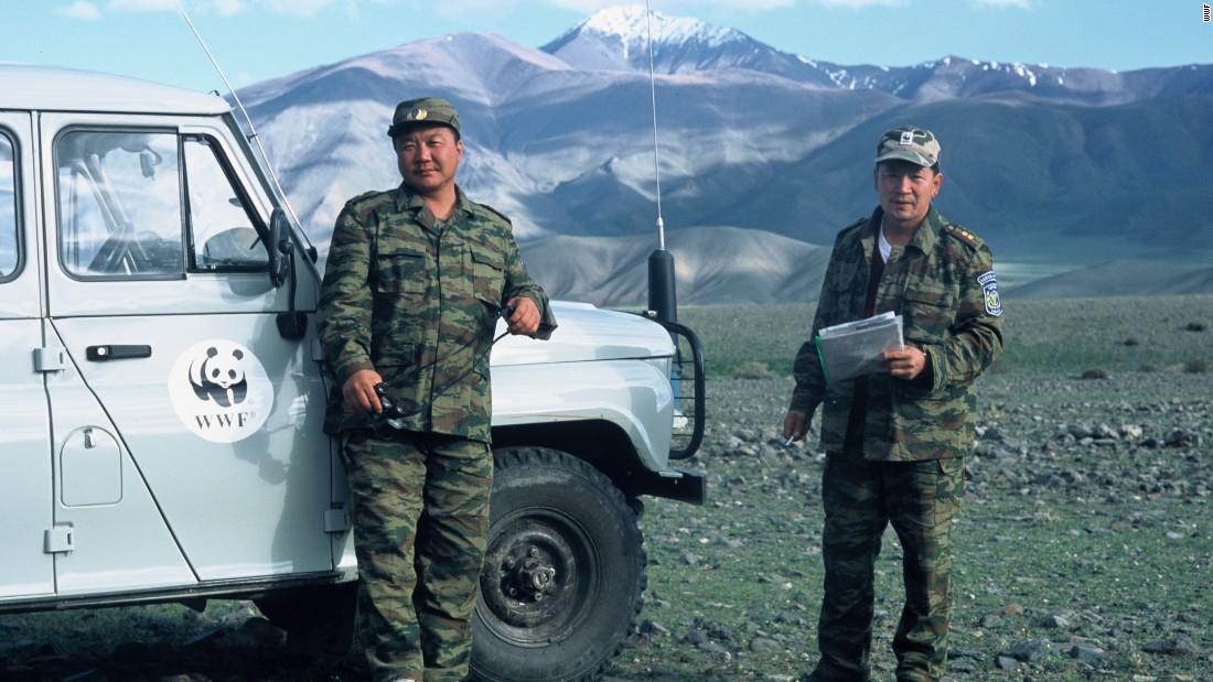 World Wildlife Fund's snow leopard anti-poaching brigade in Mongolia's Turgen Reserve. The Tsagaan Mountains -- another snow leopard reserve -- are in the background.