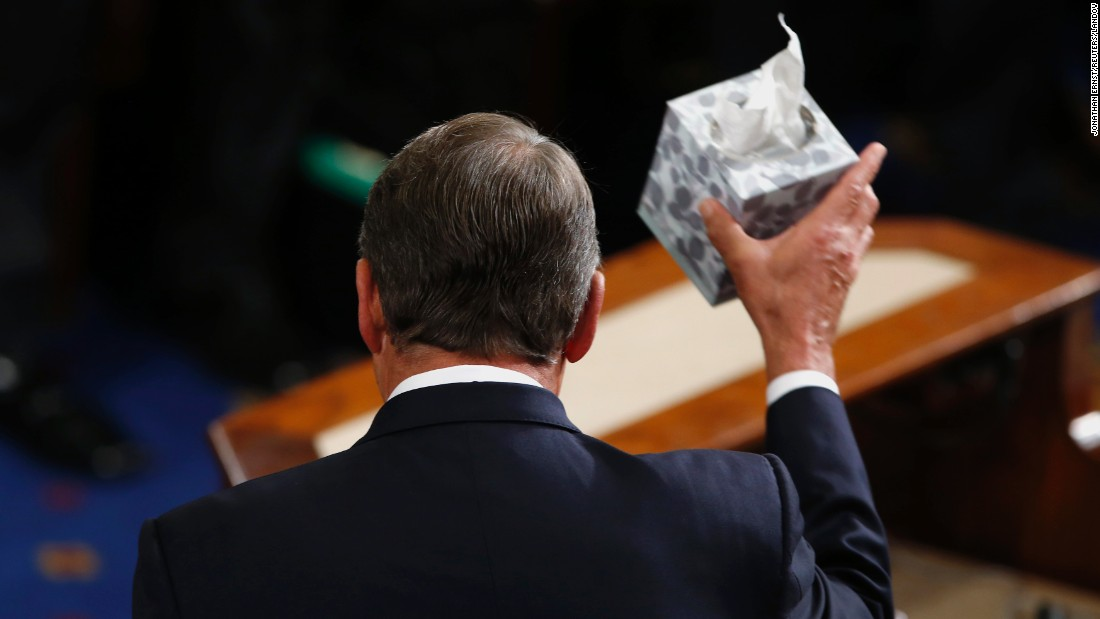 Outgoing House Speaker John Boehner waves his trademark box of tissues as he addresses colleagues before stepping down in the House Chamber of the U.S. Capitol on Thursday, October 29.