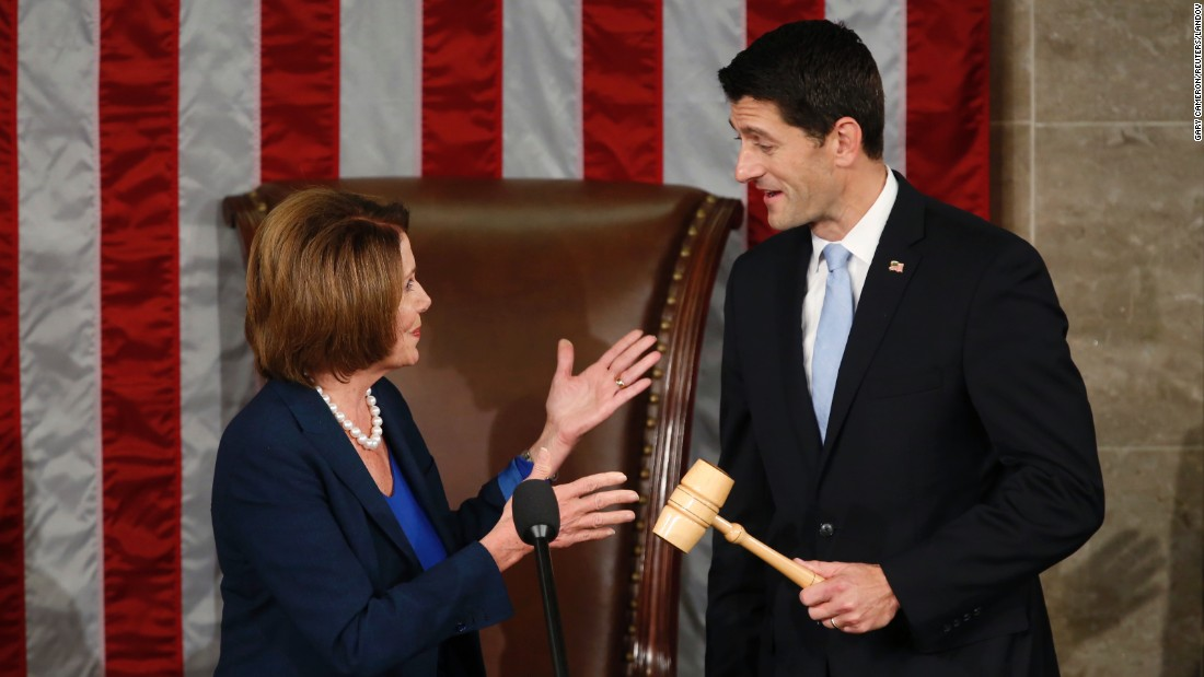 House Minority Leader Nancy Pelosi hands newly elected House Speaker Paul Ryan the gavel in the House Chamber on Thursday, October 29. Ryan was elected to succeed Boehner.
