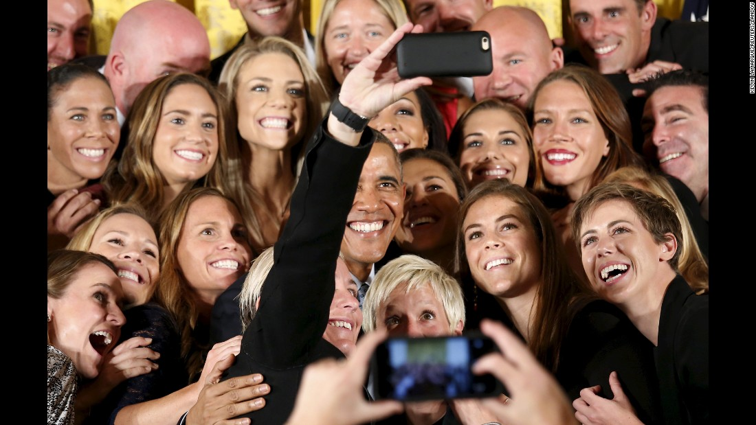 "President Barack Obama <a href=""http://www.cnn.com/2015/10/28/living/gallery/look-at-me-selfies-1028/index.html"" target=""_blank"">poses for a selfie</a> with members of the U.S. Women's National Soccer Team during an event honoring the 2015 FIFA Women's World Cup champions on Tuesday, October 27."