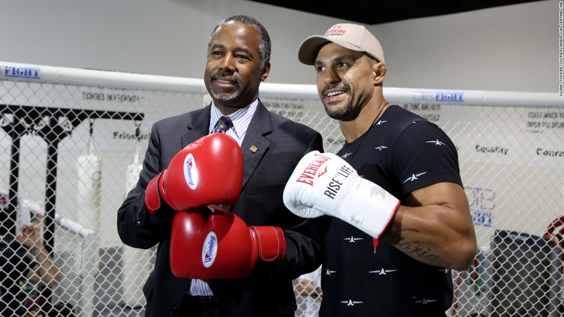 UFC middleweight fighter Vitor Belfort poses with Republican candidate Ben Carson at the OTB Fight gym in Coconut Creek, Florida, on Tuesday, October 27. Belfort is endorsing Carson.