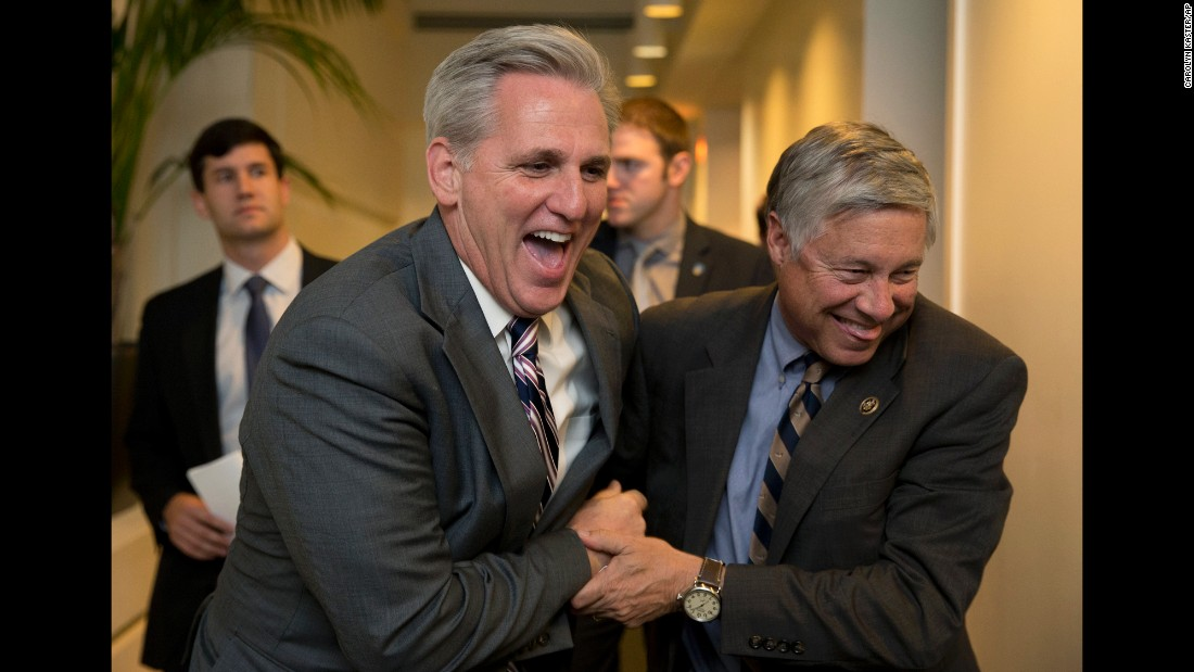 House Majority Leader Kevin McCarthy, left, and Rep. Fred Upton laugh together after a meeting on Capitol Hill on Monday, October 26.